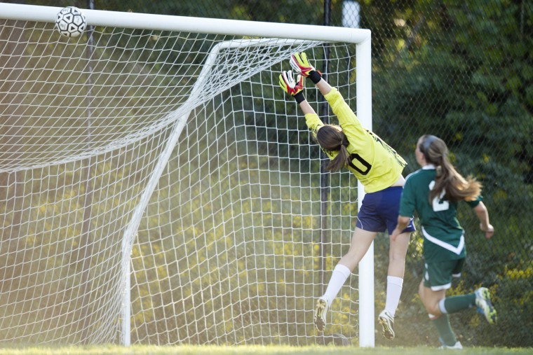 Chapelgate goalie Katherine Cameron goes up while St. John's shot hits the crossbar during the girls soccer game at Chapelgate Christian Academy in Marriottsville, MD on Wednesday, September 23, 2015. (Jen Rynda/BSMG)