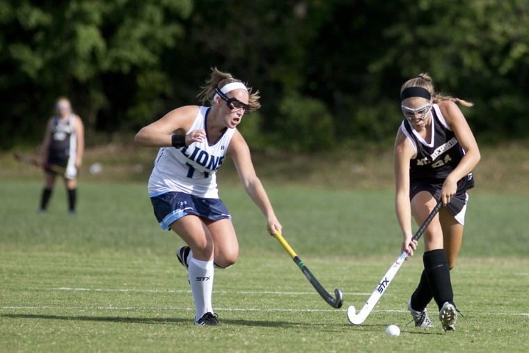 Howard's Zoe Summa, left, reaches for the ball while Mt. Hebron's Erin Demek, right, runs down field during the field hockey game at Howard High School in Ellicott City, MD on Thursday, September 24, 2015. (Jen Rynda/BSMG)