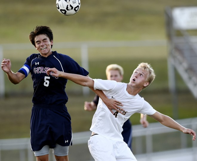 Gerstell's Luke Gardner fights for a ball in the air with South Carroll's Nick Ellis Tuesday, Sept. 8 at South Carroll High School. (Dave Munch/Carroll County Times)