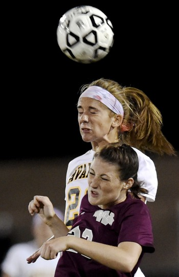 South Carroll's Sam Franklin and Winters Mill's Dharma Haas go up for a header during the second half of their game in Winfield Thursday, Sept. 24, 2015. (Dylan Slagle/Carroll County Times)