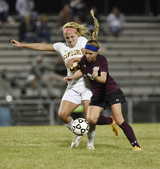 South Carroll's Mackenzie Wenczkowski, left, and Winters Mill's Hannah Klevins battle for control of the ball during the second half of their game in Winfield Thursday, Sept. 24, 2015. (Dylan Slagle/Carroll County Times)