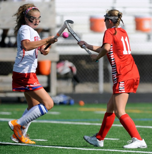 Centennial's Mary Margaret Baldy, left, and Roland Park Country School's Louisa Huber vie for a ball in the first half of a high school field hockey game in Ellicott City Tuesday, Sept. 8, 2015. (Photo by Steve Ruark)