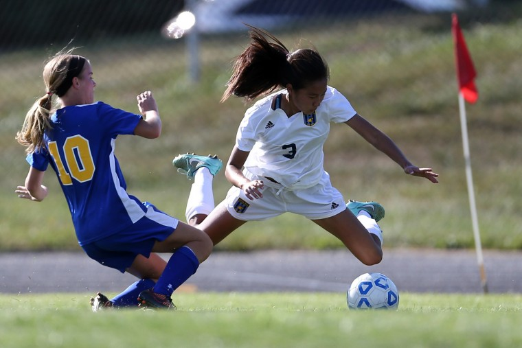 Brigette Wang, right, of River Hill collides with Brittany Oullette of Liberty during a soccer match at River Hill High School in Clarksville on Tuesday, September 8, 2015. (Matt Hazlett/For BSMG)