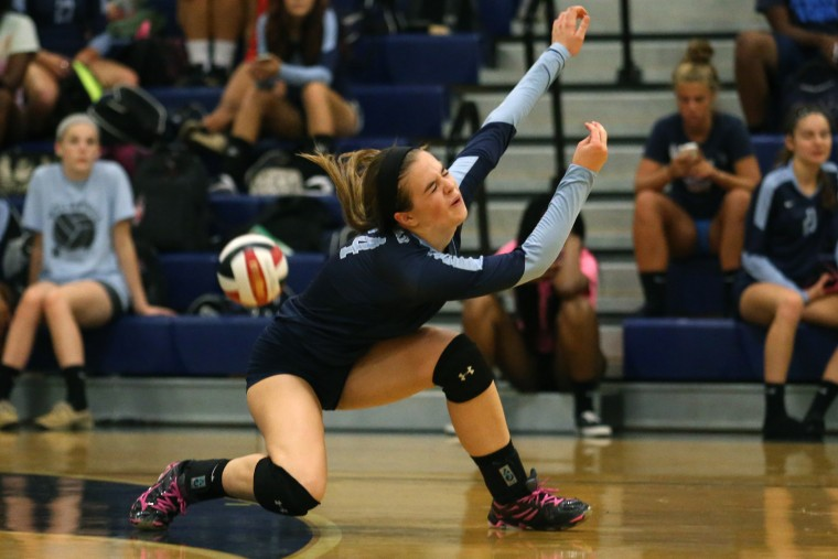 Sarah Sweet of Howard just misses the ball during a volleyball match at Howard High School in Ellicott City on Tuesday, September 8, 2015. (Matt Hazlett/For BSMG)