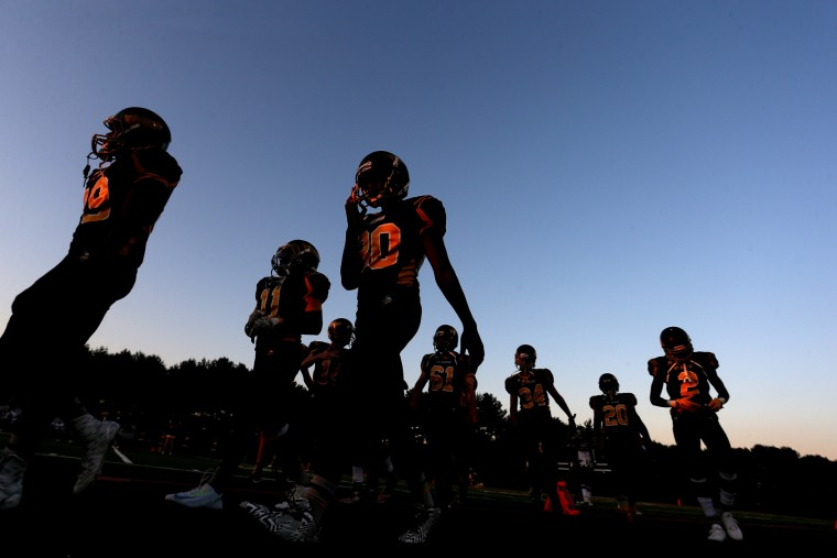 Mount Hebron Varsity football walks onto the field before a game against Hammond High School in Ellicott City on Friday, September 18, 2015. (Matt Hazlett/For BSMG)
