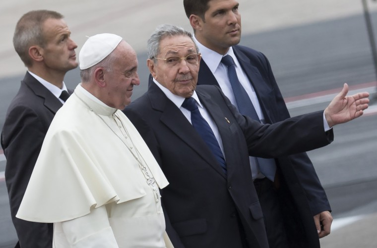 Cuba's President Raul Castro escorts Pope Francis during the pope's arrival ceremony at the airport in Havana, Cuba, Saturday, Sept. 19, 2015. Pope Francis begins a 10-day trip to Cuba and the United States on Saturday, embarking on his first trip to the onetime Cold War foes after helping to nudge forward their historic rapprochement. (Ramon Espinosa/Associated Press)