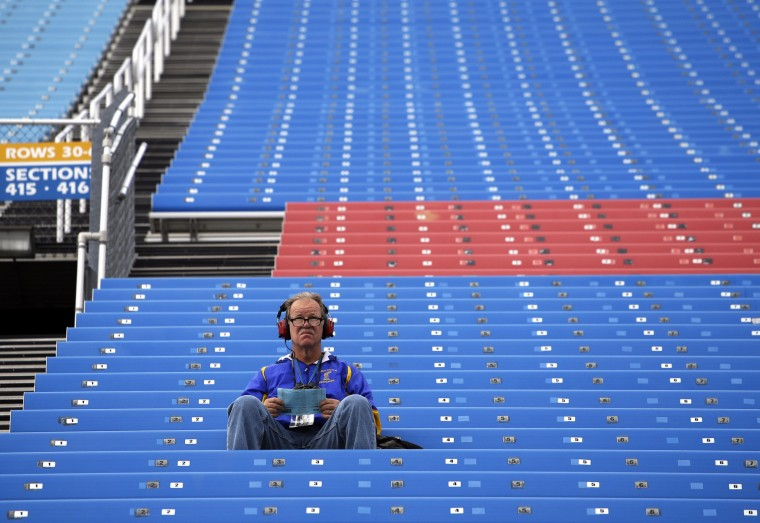 A race fan looks to the track before the NASCAR Camping World Truck Series auto race at Chicagoland Speedway, Saturday, Sept. 19, 2015, in Joliet, Ill. (Nam Y. Huh/Associated Press)