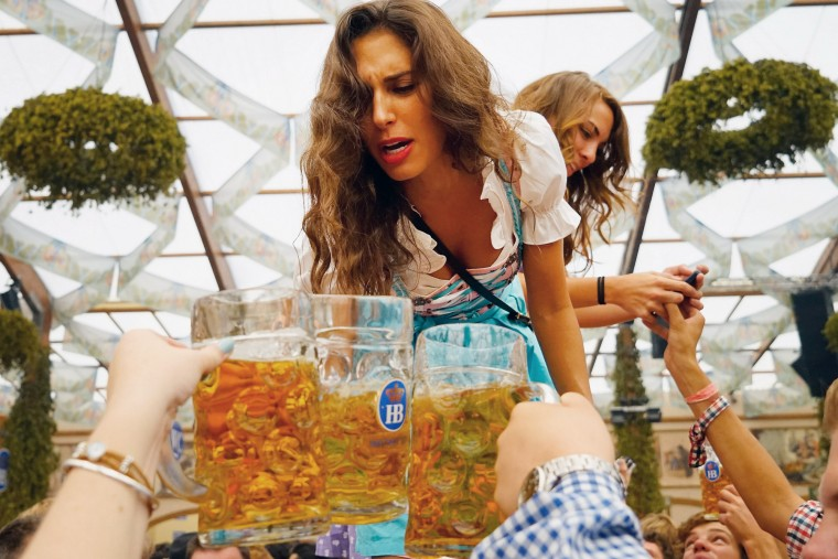 A young woman drinks beer at Hofbraeuhaus beer tent on the opening day of the 2015 Oktoberfest on September 19, 2015 in Munich, Germany. The 182nd Oktoberfest will be open to the public from September 19 through October 4and will draw millions of visitors from across the globe in the world's largest beer fest.. (Johannes Simon/Getty Images)