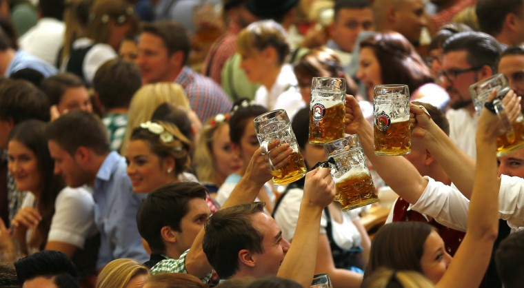 People cheer during the opening of the 182. Oktoberfest beer festival in Munich, southern Germany, Saturday, Sept. 19, 2015. The world's largest beer festival will be held from Sept. 19 to Oct. 4, 2015. (Matthias Schrader/Associated Press)