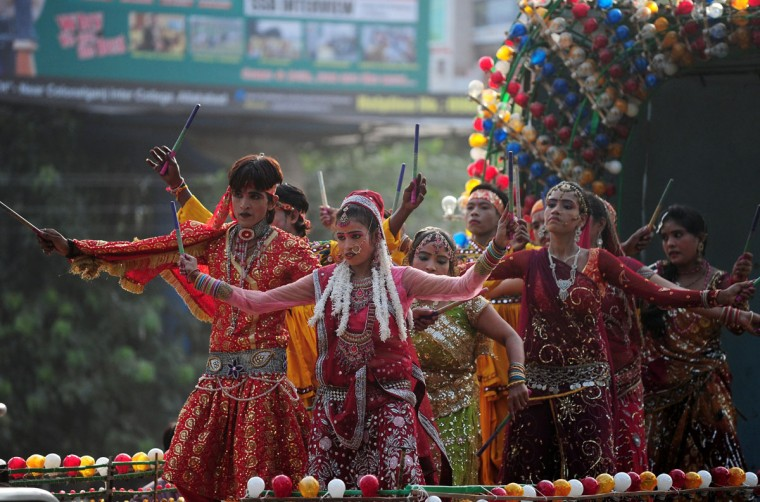 Indian performers dance during a religious procession on the eve of Janmashtami in Allahabad on September 4, 2015. (Sanjay Kanojia/AFP/Getty Images)