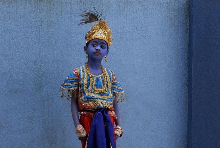 A boy dressed like Hindu Lord Krishna waits to attend celebrations on the eve of Janmashtami at a school in Mumbai, India, Friday, Sept. 4, 2015. The day marks the birth of Krishna. (AP Photo/Rajanish Kakade)