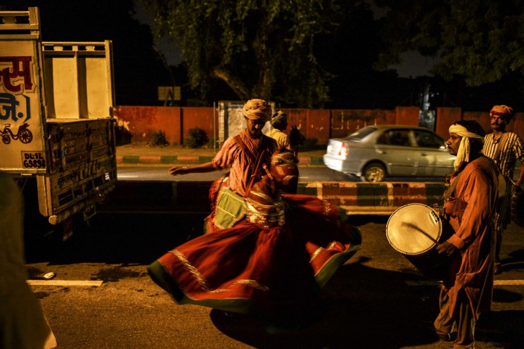 An Indian artist dances on the road during a procession marking the Hindu festival of Janmashtami, in New Delhi on September 1, 2015. (Chandan Khanna/AFP/Getty Images)