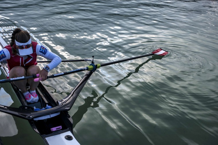 A rower prepares to go out on the lake for a practice session, on September 4, 2015 in Aiguebelette-Le-Lac, during the 2015 World Rowing Championships. (JEFF PACHOUD/AFP/Getty Images)
