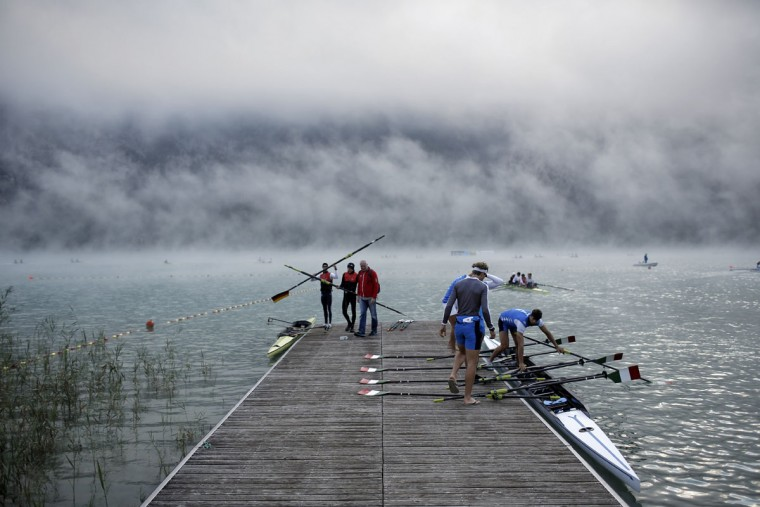 Rowers prepare to warm up in the fog in the early morning during the World rowing championships in Aiguebelette, French Alps, Friday, Sept. 4, 2015. (AP Photo/Laurent Cipriani)