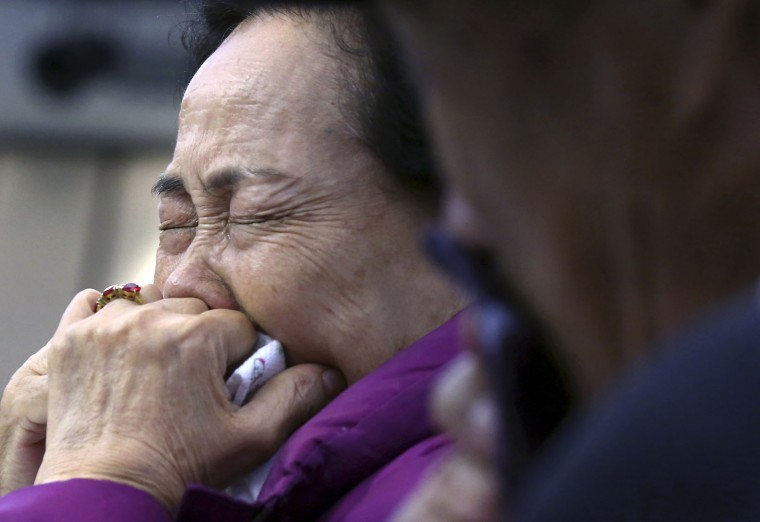 South Korean Mun Jung-ok cries as she bids farewell to her North Korean relative after the Separated Family Reunion Meeting at the Diamond Mountain resort in North Korea, Thursday, Oct. 22, 2015. Hundreds of elderly Koreans are weeping and embracing as they part - perhaps for good - after briefly reuniting for the first time in more than 60 years. About 390 South Koreans traveled to the North's scenic Diamond mountain resort earlier this week to meet for three days with relatives they were separated from during the turmoil of the 1950-53 Korean War. (Kim Do-hoon/Yonhap via AP)