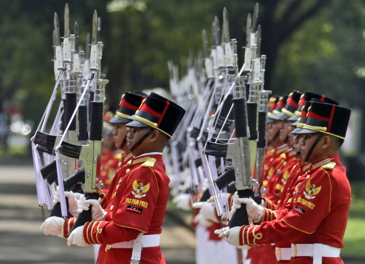Military honor guards perform a salute during a welcoming ceremony for Denmark's Queen Margrethe II and Prince Henrik at Merdeka Palace in Jakarta, Indonesia, Thursday, Oct. 22, 2015. The Danish royal couple is currently on a five-day state visit in the country. (AP Photo/Achmad Ibrahim)