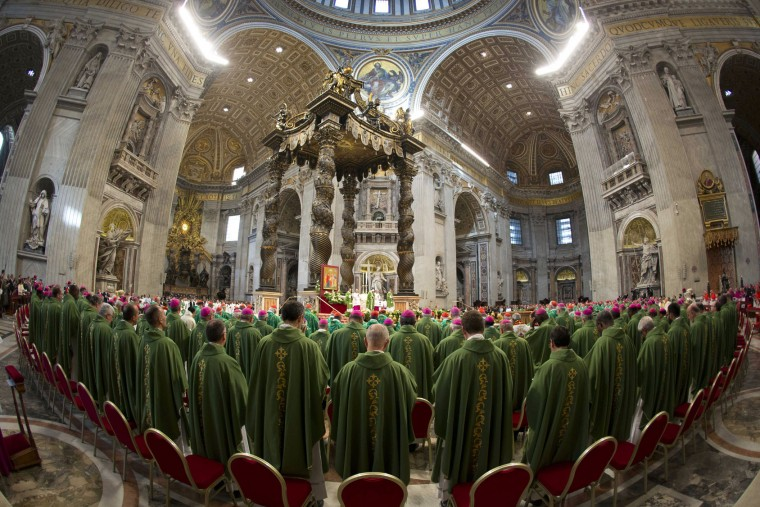 In this photo taken with a fish-eye lens Pope Francis celebrates a Mass to mark the end of the Synod of bishops, in St. Peter's Basilica at the Vatican, Sunday, Oct. 25, 2015. Catholic bishops called for a more welcoming church for cohabitating couples, gays and Catholics who have divorced and civilly remarried, endorsing Pope Francis' call for a more merciful and less judgmental church. (AP Photo/Alessandra Tarantino)