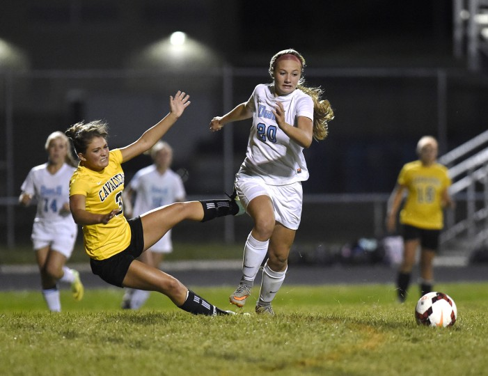 Westminster sophomore Taylor Whitmer chases the ball as South Carroll senior Anna Ratti goes down in the second half of the Owls' 3-1 win over South Carroll in Westminster Monday, Oct. 12, 2015. (Dylan Slagle/Carroll County Times)