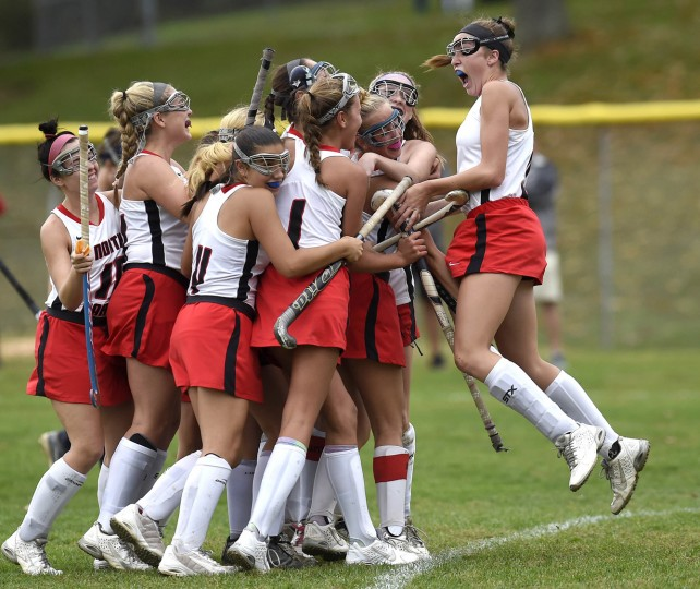 North Carroll teammates celebrate with Jensyn Koontz after she scored to tie the game in the second half of the Panthers' 2-1 win over Manchester Valley in Hampstead Tuesday, October 13, 2015. (Dylan Slagle/Carroll County Times)