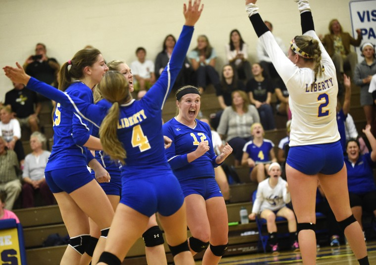 From left, Emily Eckles, Taylor Fowlkes, Hanna Jascur, Caroline Dangel and Kasey Bost celebrate after Liberty won their second game during their win over Century in Eldersburg Tuesday, October 13, 2015. (Dylan Slagle/Carroll County Times)