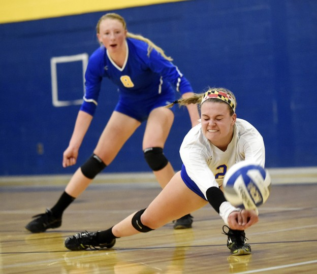 Liberty's Kasey Bost goes for a dig during the second game of the Lions' win over Century in Eldersburg Tuesday, October 13, 2015. (Dylan Slagle/Carroll County Times)