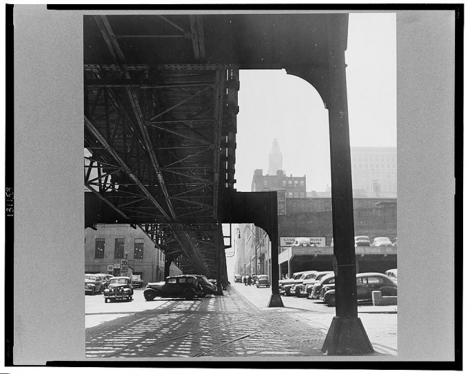 """Under the elevated trolley. The Baltimore Trust building is in the distance"""