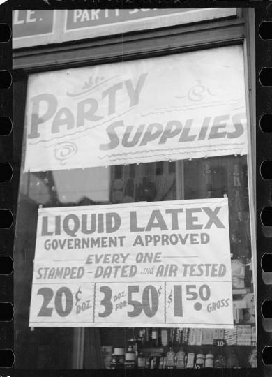 Sign, Baltimore street, Baltimore, Maryland. (Arthur Rothstein / April 1939)