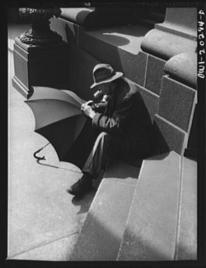 """""""A man repairing an umbrella."""" John Vachon, April 1943"""