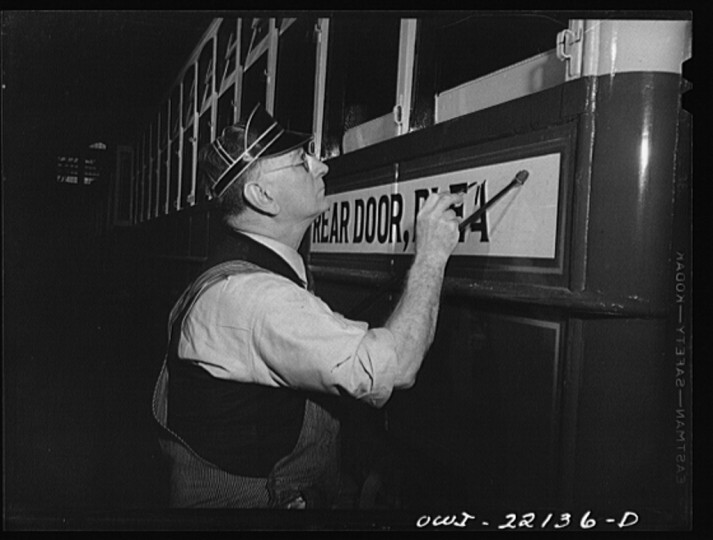 """Painting a sign on a trolley at the paint shop of the maintenance terminal of the Baltimore Transit Company"""