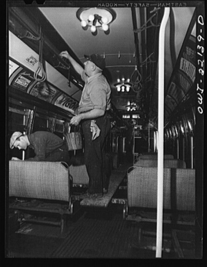 """Varnishing and repairing the interior of a trolley at the paint shop of the maintenance terminal of the Baltimore Transit Company"""