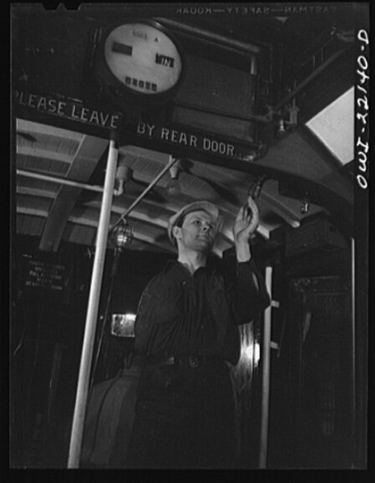 """One-armed painter, hired since the war, repainting the interior of a trolley at the paint shop of the maintenance terminal of the Baltimore Transit Company"""