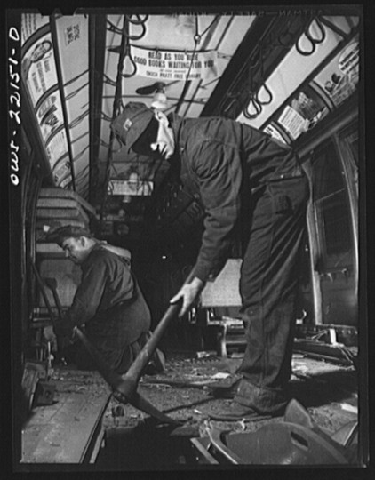 """Starting to repair the interior of a wrecked trolley at the damage repair shop of the maintenance terminal of the Baltimore Transit Company"""