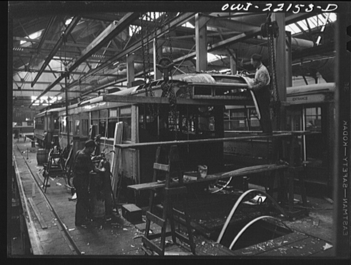 """Repairing a wrecked trolley at the damage repair shop of the maintenance terminal of the Baltimore Transit Company"""