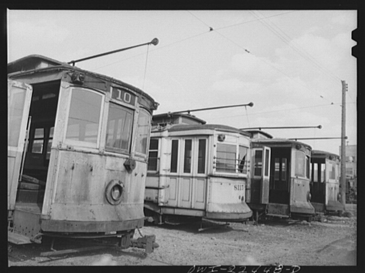 """Trolley junk in the yard at the Washington terminal, maintenance plant of the Baltimore Transit Company. Most of these trolleys were built before 1907 and are too old to recondition despite wartime needs"""