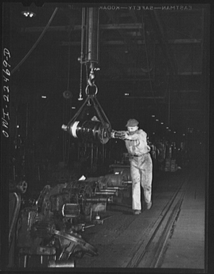 """Hauling armature of a trolley motor to be overhauled at the amature shop at the Washington terminal, maintenance plant of the Baltimore Transit Company"""