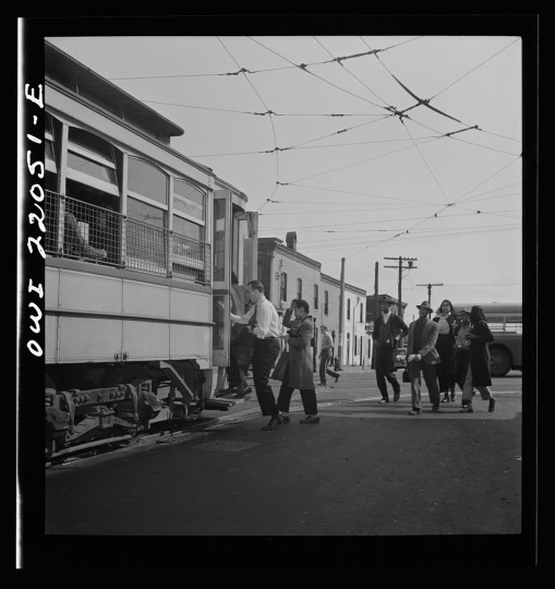 """Workers rushing to catch the trolley home at four p.m."""