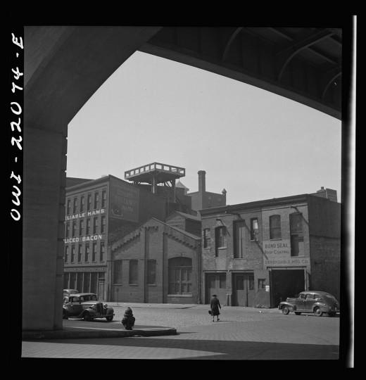 """Street under viaduct."" Marjory Collins, April 1943"