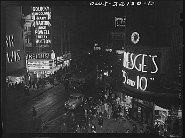 """""""Shopping district just before closing time at nine p.m. on Thursday night."""" Marjory Collins, April 1943"""