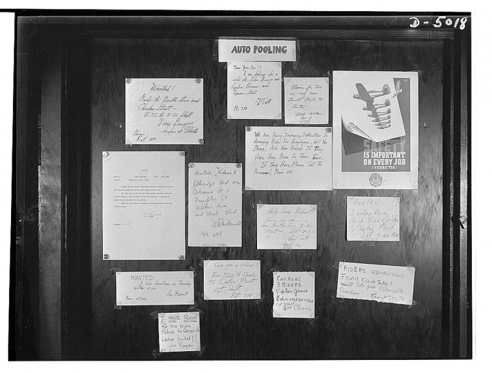 """Transportation. Car pooling at Glenn Martin. On the """"auto pooling"""" bulletin board in the Glenn Martin aircraft plant, car owners willing to carry extra passengers list information on their routes and destinations. (Howard Liberman / June 1942)"""