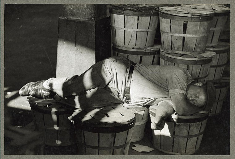 """Man sleeping in fish market."" Photo by Sheldon Dick, July 1938"