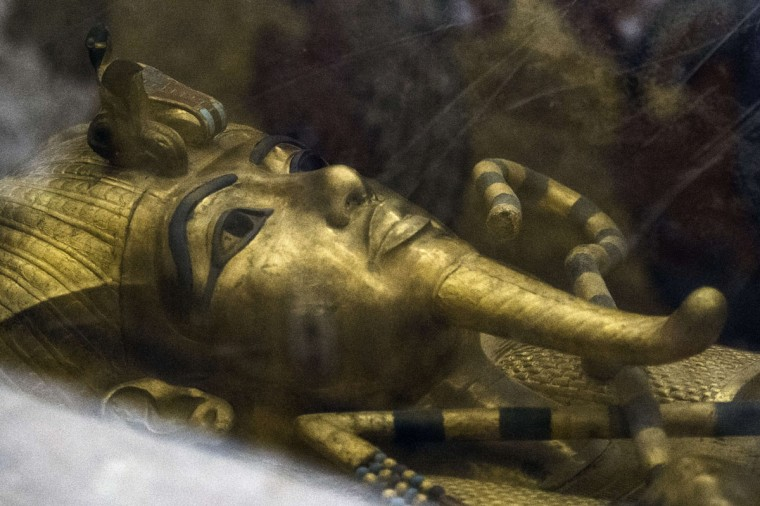 A picture taken on September 28, 2015 shows a detail of the golden sarcophagus of King Tutankhamun in his burial chamber in the Valley of the Kings, close to Luxor, 500 kms south of Cairo. British Egyptologist Nicholas Reeves, who believes the legendary Queen Nefertiti may be buried in a secret room adjoining Tutankhamun's tomb arrived in Egypt to test his theory. To this day, Nefertiti's final resting place remains a mystery. (KHALED DESOUKI/AFP/Getty Images)