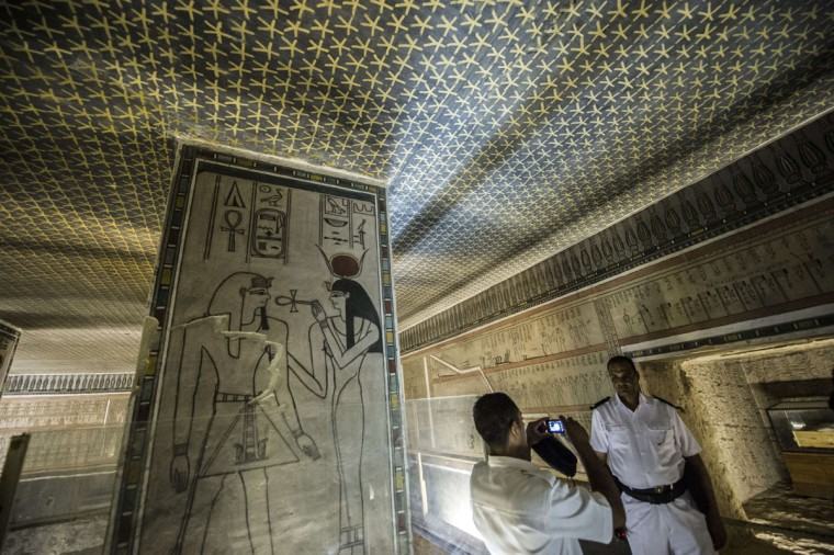 A picture taken on September 29, 2015 shows an Egyptian policeman photographing his colleague inside the Horemheb tomb at the Valley of the Kings, close to Luxor, 500 kms south of Cairo. (KHALED DESOUKI/AFP/Getty Images)