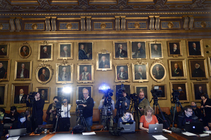 Journalists wait for the beginning of a press conference of the Nobel Committee to announce the winner of the 2015 Nobel Prize in Physics on Tuesday at the Swedish Academy of Sciences in Stockholm, Sweden. Takaaki Kajita of Japan and Canada's Arthur B. McDonald won the Nobel Physics Prize for work on neutrinos. (FREDRIK SANDBERG/AFP/Getty Images)