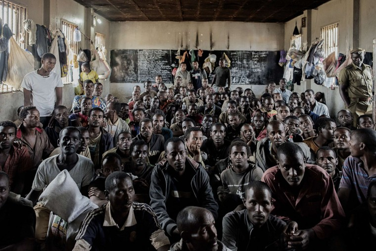 Some of the 200 Ethiopian nationals detained in Maula Prison for illegal immigration sit on the floor of the prison in Lilongwe, Malawi, on June 1, 2015. Malawi, which is a transit route for many Ethiopians, Somalis and other Africans seeking work in South Africa, says it has seen a sharp rise in migrants in recent months. (AFP Photo/Mauricio Ferretti)