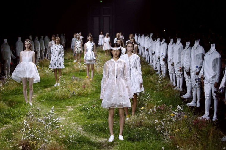 Models present creations for Moncler Gamme Rouge during the 2016 Spring/Summer ready-to-wear collection fashion show, on October 7, 2015 in Paris. (AFP Photo/Patrick Kovarik)