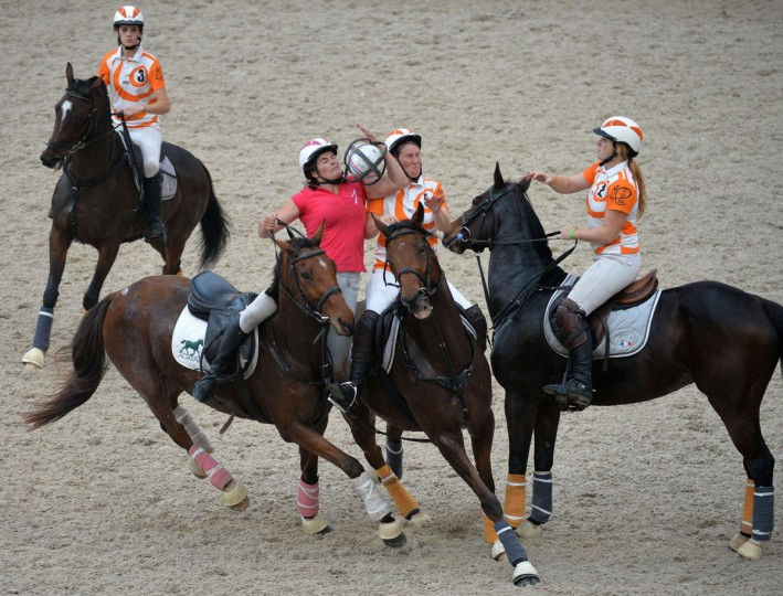 France's Coutainville Agrial horse rider Mathilde Dubosq (2-L), riding Maliana, vies for the the ball with France's Coutainville horse rider Sarah Dedeurwaerder (M) riding Fautiglote during the Pro Elite match Coutanville Agrial (France) versus Meurchin (France) of the FIHB Champions League 2015 Ladies and Pro Elite, on October 11, 2015 at the European Horse Centre in Yvre-l'Eveque near Le Mans, western France. (AFP Photo/Jean-francois Monier)