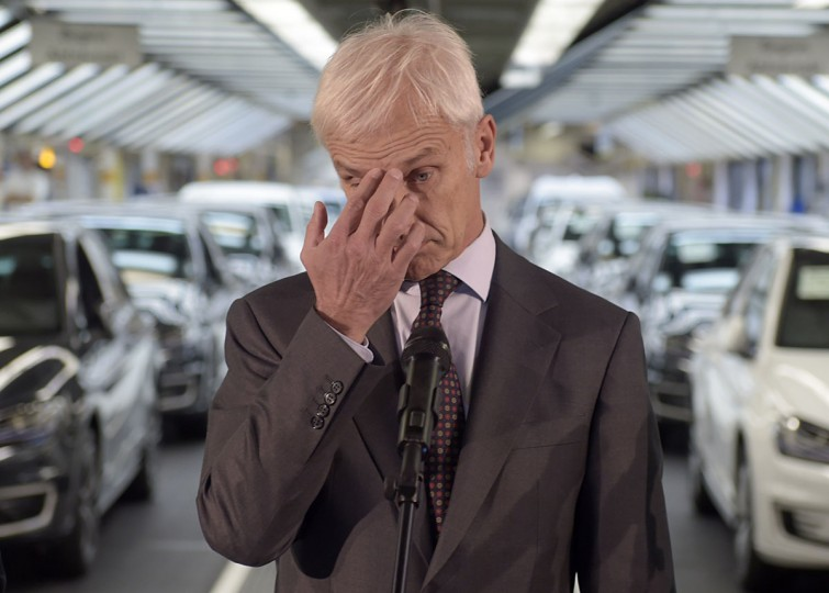 Matthias Mueller, CEO of German car maker Volkswagen, gestures while addressing journalists after visiting an assembly line of the VW plant in Wolfsburg, central Germany, on October 21, 2015 . Volkswagen shook Germany's powerful automobile industry with revelations in September 2015 that it had fitted 11 million of its diesel vehicles with software designed to cheat official pollution tests. (AFP Photo/Odd Andersen)