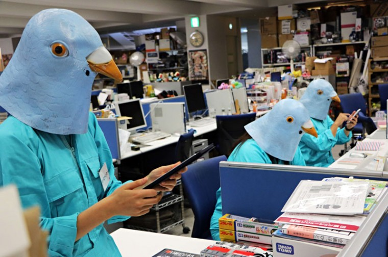 Employees of Japanese toy company Tomy dressed as Twitter birds work at their desks during the company's Halloween Day event at the company headquarters in Tokyo on Tuesday. Employees for the Japanese toymaker were allowed to wear their favourite costumes in observance of the holiday. (YOSHIKAZU TSUNO/AFP/Getty Images)