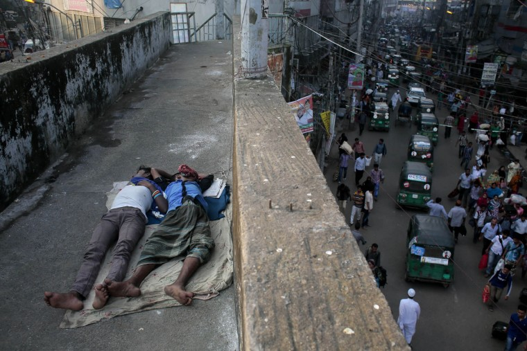 Homeless Bangladeshi boys sleep on an overpass early morning in Dhaka, Bangladesh, Thursday, Oct. 1, 2015. Despite the government's banning of several radical Islamic groups, intelligence sources have confirmed that several hard-line groups are active in Bangladesh where almost 90 percent of its 160 million people are Muslim. (AP Photo/ A.M. Ahad)