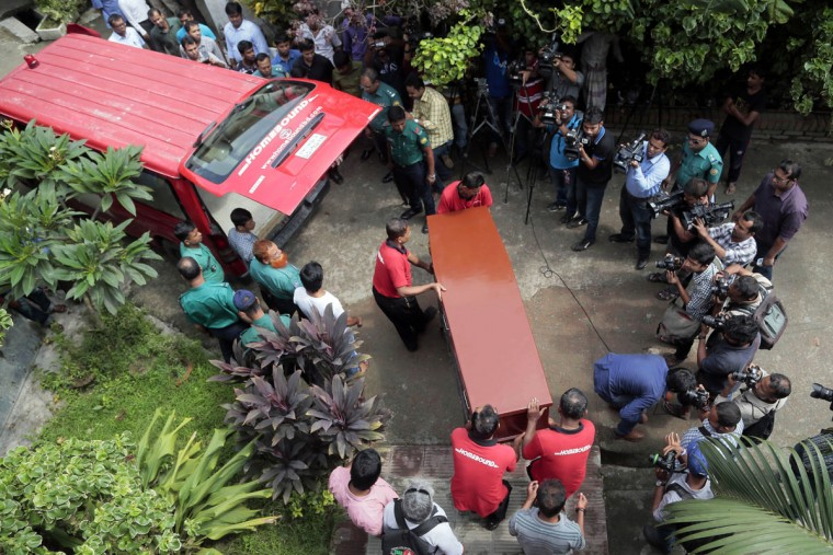 The body of Italian citizen Cesare Tavella, who was gunned down by unidentified assailants, is carried towards a waiting ambulance in Bangladesh, in Dhaka, Bangladesh, Wednesday, Oct. 14, 2015. The recent killings of two foreigners in the country, Tavella and a Japanese, has spooked tourists and expatriates in the impoverished South Asian nation, raising alarms about whether Islamic radicals are gaining a foothold and whether foreigners are safe in the moderate, secular nation. (AP Photo/A.M. Ahad)